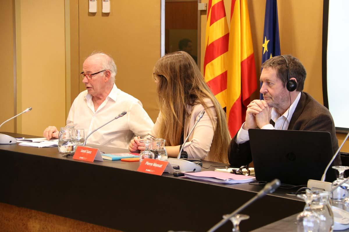 Pierre Mansat, Janet Sanz i Jordi Borja durant la trobada